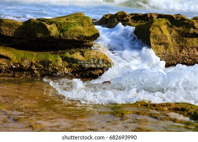 Sprays and waves on a rocky beach