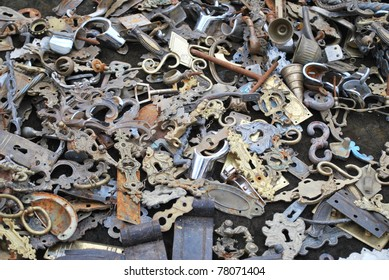 Spread collection of old heyholes, knobs,  and hinges