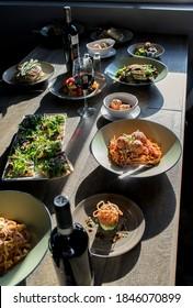 Spread of Italian dishes and wine in Italian restaurant