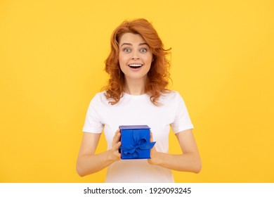 Spread a little happiness. Surprised girl hold gift box yellow background. Surprise gift. Birthday present. Boxing day. Holiday giveaway. woman with present.