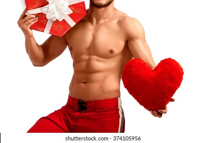 Spread the love. Cropped shot of a ripped and fit male model posing with red heart isolated on white copyspace on white background