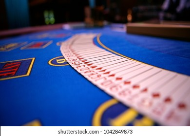 Spread out platying cards on casino table