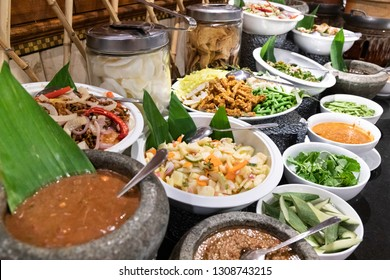 Spread of Ulam, traditional Malay food of raw vegetable with chili dipping