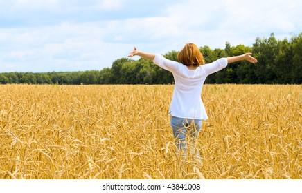 Spreadeagled woman in the gold field