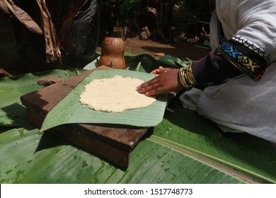 Spreading out the dough to prepare for cooking it, made from fake banana leaves by the Dorze Tribe in Omo Valley Ethiopia