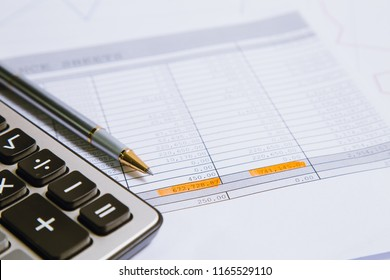 Spreadsheet bank accounts accounting with calculator.Concept for financial fraud investigation, audit and analysis.