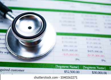 Spreadsheet table paper with stethoscope. Finance development, Banking Account, Statistics Investment Analytic research data economy, trading, Mobile office reporting Business company meeting concept.