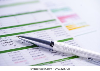 Spreadsheet table with pen. Finance development, Banking Account, Statistics Investment Analytic research data economy, trading, Mobile office reporting Business company meeting concept.