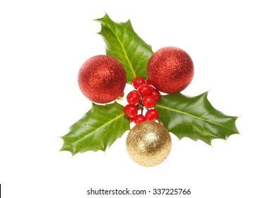 Sprig of Holly with Christmas baubles isolated against white