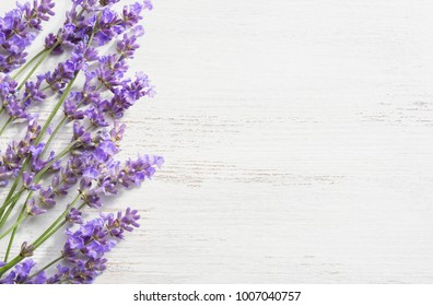 Sprigs of lavender on  wooden shabby background