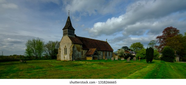 Spring afternoon light on the church of St Peter Ad Vincula - now no longer in regular use - in the village of Colemore within the South Downs National Park, Hampshire, UK
