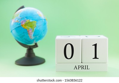 Spring april 1 Calendar. Part of a set on blurred green background and globe.