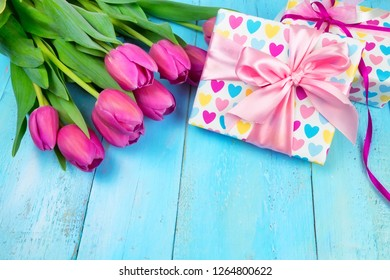 Spring background. Bouquet of flowers on a wooden background and a nest with eggs. spring