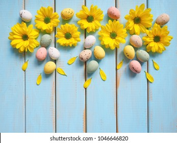 Spring background with gerbera daisy flowers and Easter eggs