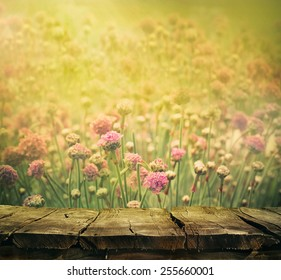 Spring background with tabletop. Flowers background. Wood table