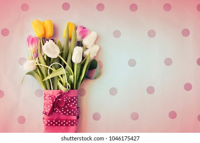 Spring background with Tulips flowers in vintage color, top view