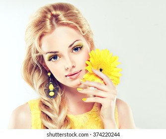 Spring   beautiful model  girl  with yellow makeup and manicure nails . Fashion make up