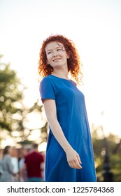 dc265f24f3 Spring beauty girl with red curly hair outdoors. Romantic young woman  portrait. Woman dressed