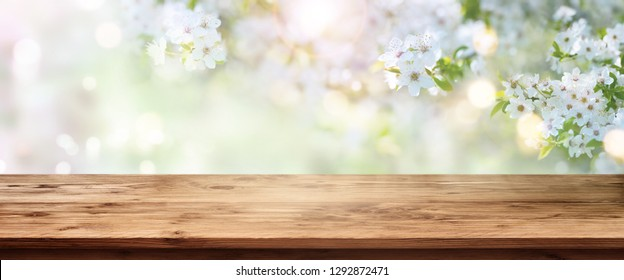 Spring blossoms with wooden table for a background decoration