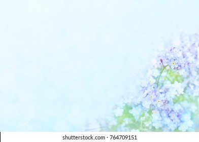 Spring blue forget-me-nots flowers posy, pastel background, selective focus, toned card