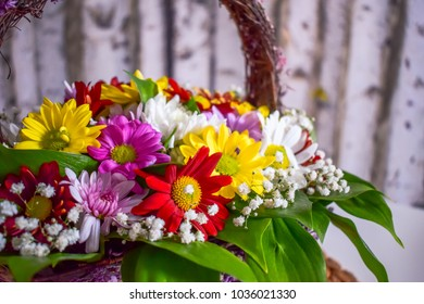 Spring bouquet of flowers in a basket
