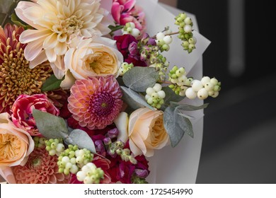 Spring bouquet of flowers with roses closeup. Peony rose, tulips, dahlia, aster. Flower shop. Spring. Flower Background. Wallpaper. Woman's day.