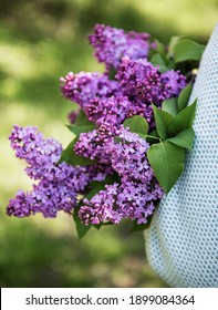 Spring bouquet of lilacs in woman hands. Lilac flowers.