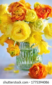 Spring bouquet of a yellow flowers on a blue light background.