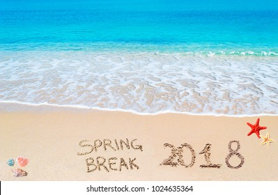 Spring break 2018 written on the sand