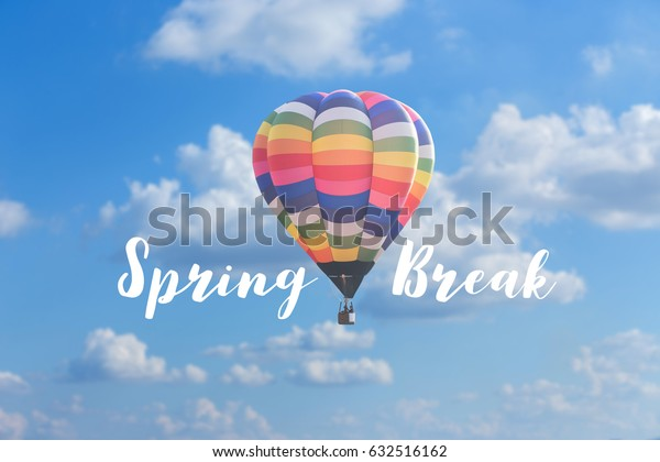 Spring break with colorful hot air balloon on blur clouds blue sky background