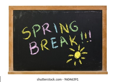 Spring Break written in colorful chalk on a chalkboard isolated on white.  There is also a sketched sun on the blackboard.