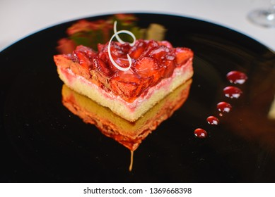 Spring cake with strawberry jam and fresh strawberries