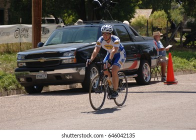 Spring City, Utah, USA - 2 August 2006: Woman crosses the finishing line of the Sanpete Classic Road Race in Sanpete County Utah. One woman cycling in a road bike race in rural Utah.