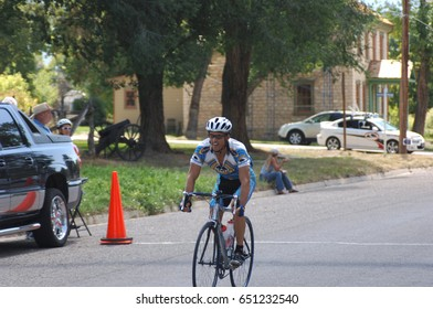 Spring City, Utah, USA - 2 August 2006: Man riding for team Porcupine Pub and Grille crosses the finish line in the Sanpete Classic Road Race in Sanpete County Utah. Friendly road race in rural Utah.
