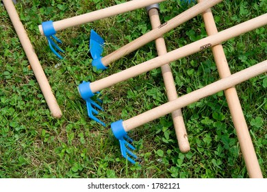 Spring Clean. Rake, mattock and hoe.