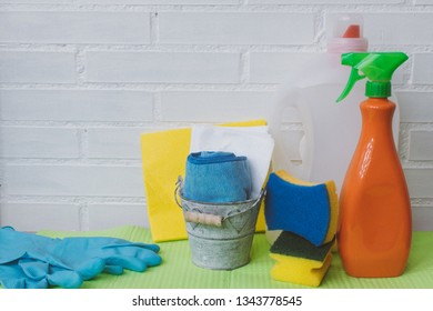 Spring cleaning background with space for copy text. Cleaning up tools. Plastic spray, sponge, gloves and desinfectant products.