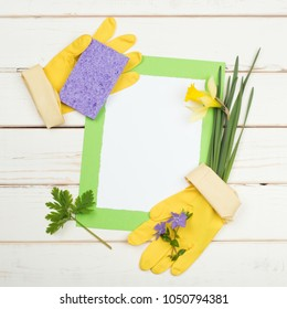 Spring Cleaning card for List of Chores with flowers, sponge, yellow gloves on rustic and distressed white board background with room or space for your words, text, copy or design. Square from up high