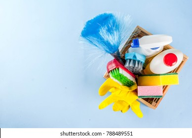 Spring cleaning concept with supplies, house cleaning products pile. Household chore concept, on light blue background copy space top view