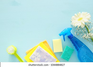 Spring cleaning concept with supplies on wooden table
