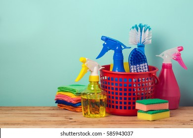 Spring cleaning concept with supplies over mint background