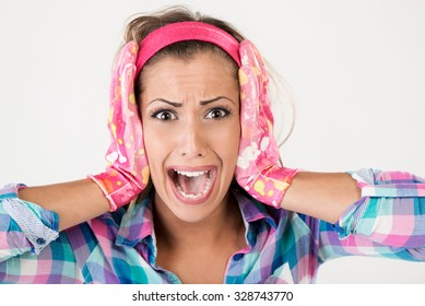 Spring cleaning woman screaming. She is stressed, wearing pink rubber gloves and looking at camera. White background.