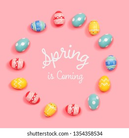 Spring is coming message with round frame of Easter eggs