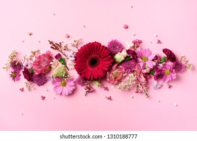 Spring composition of pink flowers on punchy pastel background with copy space. Creative layout. Flat lay. Top view. Summer minimal concept