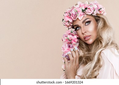 Spring concept. Beautiful natural woman in wreath with flowers . Spring makeup girl portrait. Beauty portrait of female face with natural skin. Spring fashion photo. Skin care concept, beauty spa, bio