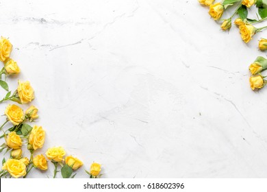 spring concept with flowers on white marble table background top view mockup