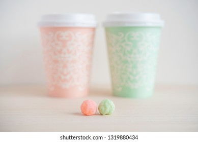 "Spring concept,  kawaii coral pink and mint green japanese snack ""hina-arare"". Couple or family or friends image."