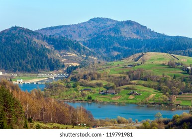 Spring country landscape with village and river