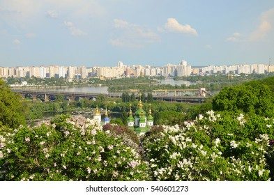 spring day in blossoming lilacs church into phonemes river and big city