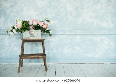 Spring decor and flower arrangements. Plastic rose flowers  home decoration with white space for text.Lovely romantic background with  pink peony flowers.