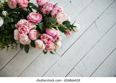 Bouquet Of Roses And Freesias Represented On White Wooden Background